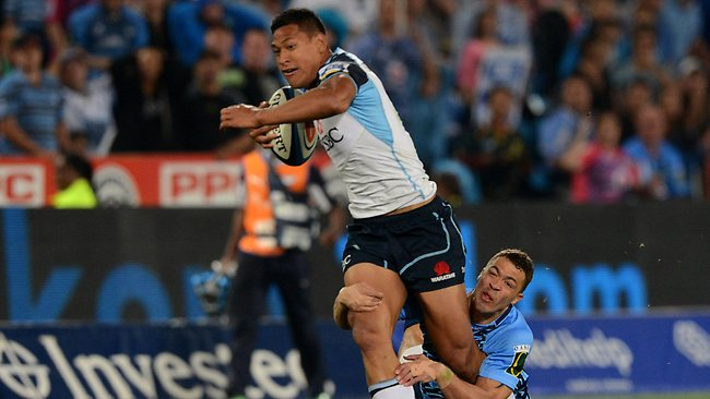 Israel Folau of Waratahs gets tackled by Bjorn Basson of the Bulls during the Super Rugby match in Pretoria. Picture: Duif du Toit