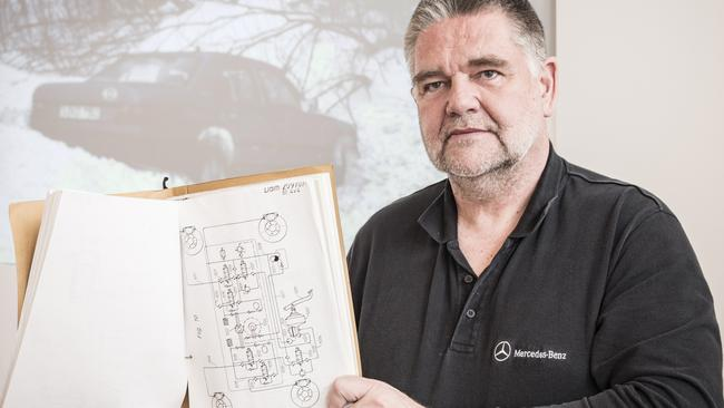 Mercedes-Benz safety engineer Frank Werner-Mohn with the original patent application for stability control. Picture: Daniel Maurer.