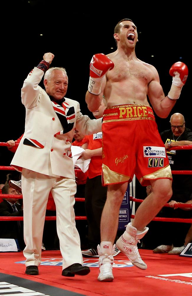 David Price celebrates victory over Audley Harrison in 2012 with Frank Maloney also in the ring.