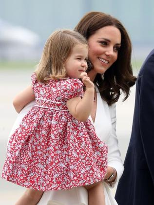 The Duchess of Cambridge carries Princess Charlotte as they arrive in Warsaw, Poland. Photo by Chris Jackson/Getty