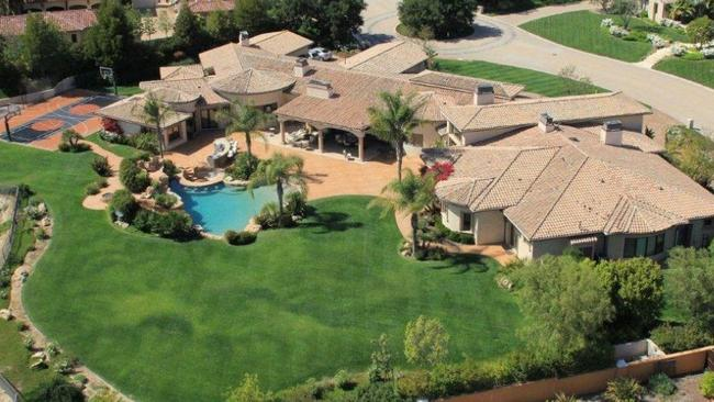 The beautiful backyard features sprawling lawns, a resort-style pool and a basketball court. Picture: Zillow.com