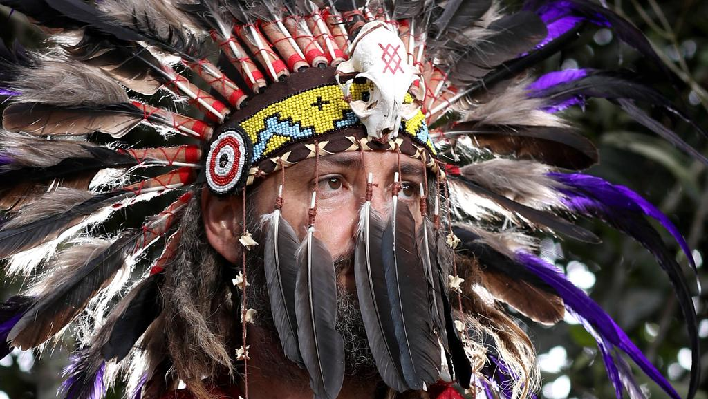 "Modern day shaman West wears a locally-made headdress he uses in rituals he says are designed to help people experience the ""Divine Entity"". PICTURE: MARC MCCORMACK"