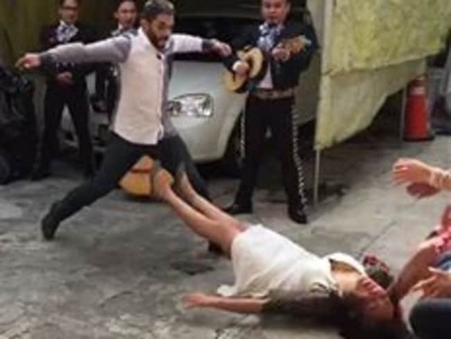 Is this being head over heels in love? Germán Benítez Giles rushes to his girlfriend Reyna Rentería's aid after she faints after he proposed. Picture: Reyna Rentería / Facebook