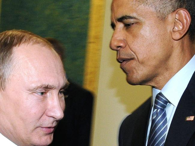 (FILES) This file photo taken on November 30, 2015 shows Russian President Vladimir Putin (L) meeting with US President Barack Obama on the sidelines of the UN conference on climate change - COP21 in Le Bourget, on the outskirts of the French capital Paris.  Russia on December 30, 2016 eyed retaliatory measures against the US after President Barack Obama kicked out dozens of suspected intelligence agents and imposed sanctions in a furious dispute over alleged election interference. The barrage of punishment against Moscow over cyberattacks dragged ties between Russia and the United States -- already at their worst since the Cold War -- to a fresh low less than a month ahead of President-elect Donald Trump taking charge. / AFP PHOTO / SPUTNIK / MIKHAIL KLIMENTYEV