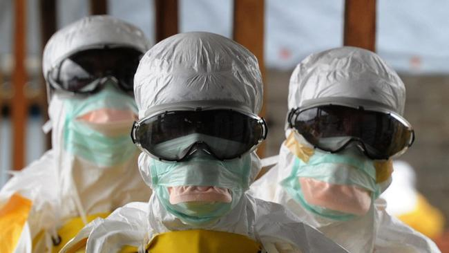 French NGO Medecins Sans Frontieres health care workers in Monrovia, Liberia, treating Ebola patients in 2014. An outbreak in west Africa between December 2013 and January 2016 affected 28,816 people, killing 11,310.
