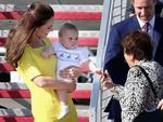 Prince George cordially greets a well-wisher on the tarmac. Prince William, Duke of Cambridge, Prince George of Cambridge and Catherine, Duchess of Cambridge arrive at Sydney Airport. Picture: Getty