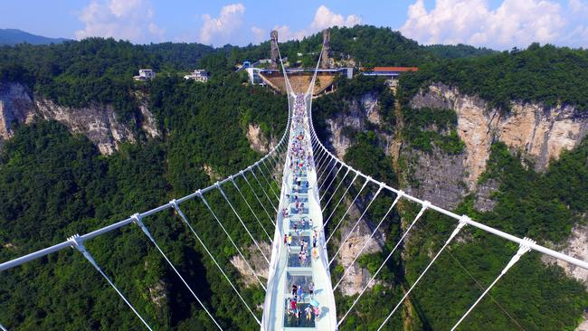 Longest Glass Bridge In The World Opens In China - China opens worlds longest skywalk