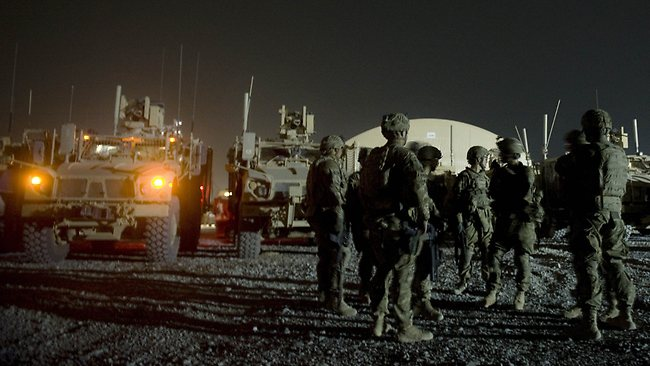 Infantry men attend a briefing prior to embarking on a night patrol from Lindsey foward operating base in Kandahar province, Afghanistan. Picture: Tony Karumba