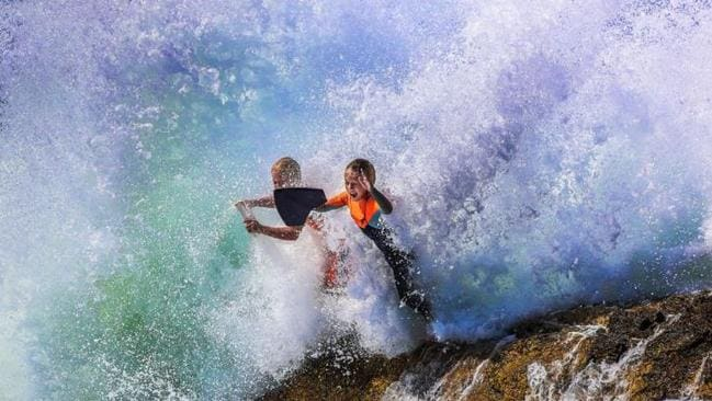 Zukas Loining and Tommy Horn at Snapper Rocks earlier this month. The swell is expected to pick up this week. Picture: Nigel Hallett