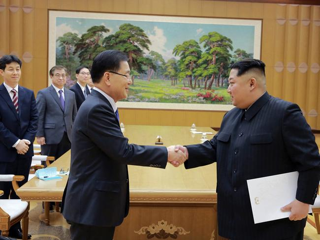 North Korean leader Kim Jong-un, right, shakes hands with South Korean National Security Director Chung Eui-yong after accepting a letter from South Korean President Moon Jae-in. Picture: Korean Central News Agency/Korea News Service/AP