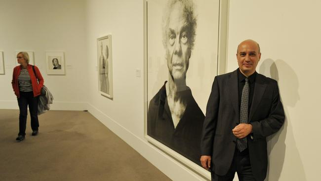 Art Gallery of Western Australia director Dr Stefano Carboni in front of some pieces from the Richard Avedon exhibition.