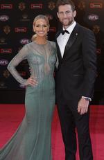 Collingwood player Jeremy Howe and his partner pose for photos on arrival at the Brownlow medal ceremony at Crown in Melbourne, Monday, September 25, 2017. Picture:AAP Image/Julian Smith