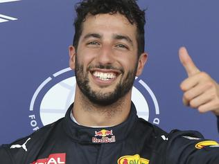 Red Bull driver Daniel Ricciardo of Australia thumbs up after setting the third best time in the qualifying session at the Baku circuit, in Baku, Azerbaijan, Saturday, June 18, 2016. The Formula One Grand Prix of Europe will be held on Sunday. (AP Photo/Luca Bruno)