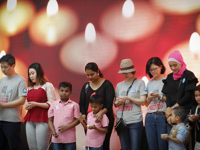 Relative of passengers on board MH370 have a moment of silence during the Day of Remembrance event in Kuala Lumpur earlier this month. Picture: AP