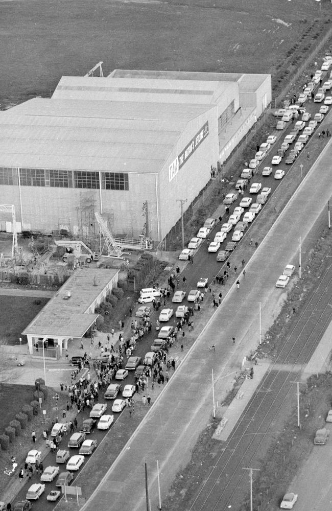 June 14, 1964: The crowds line the roads near Essendon Airport where the band touched down. Picture: Herald Sun Image Library