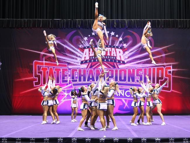 Members of the Queensland Cheer Elite squad perform at the All Star State Cheerleading Championships.