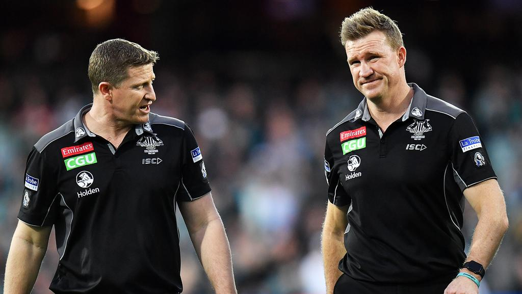 Magpies midfield coach Scott Burns with senior coach Nathan Buckley. Picture: Getty Images