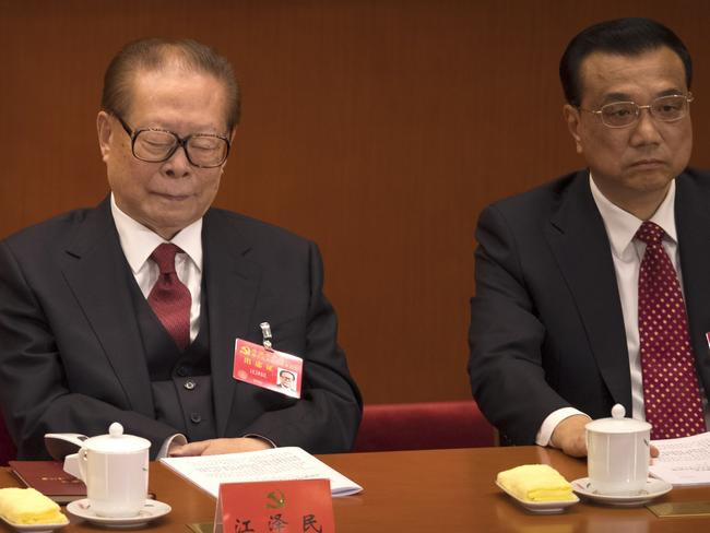 Former Chinese President Jiang Zemin closes his eyes during the President's long speech. Picture: Mark Schiefelbein/AP