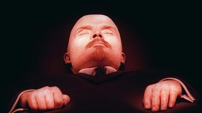 Hilarious: the embalmed body of Soviet founder, Vladimir Lenin, draws queues of serious viewers. Picture: AP.