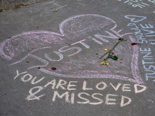 Chalk messages and signs left where Justine Damond was killed by Minneapolis Police. Picture: Jules Ameel