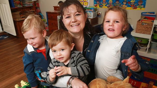 Early childhood educator Heather Town at her All Areas Family Day Care with kids she looks after (from right) James, 3, Ethan, 20 months and Abby, 3. Picture: Toby Zerna