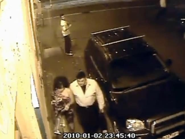 The couple pictured on CCTV walking back towards their car seconds before the attack.