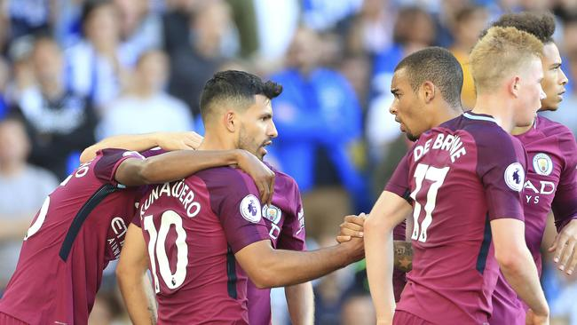 Manchester City's Sergio Aguero, centre, celebrates scoring his side's first goal.