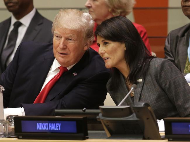 US President Donald Trump speaks with US ambassador to the United Nations Nikki Haley before a meeting during the US General Assembly. Picture: AP Photo/Seth Wenig