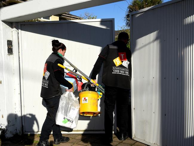 Crime scene cleaners arrive at the house on Tuesday morning. Picture: Nicole Garmston
