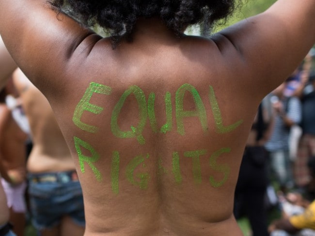 An activist during the Go Topless Day Parade in New York. Photo: AP/Kevin Hagen