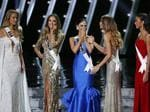 The final five contestants, including Miss Philippines Pia Alonzo Wurtzbach react on stage at the Miss Universe Pageant. Picture: AP
