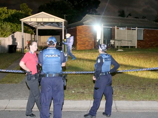 Police outside the Francoise Street, Eagleby, home last night. Picture: Steve Pohlner