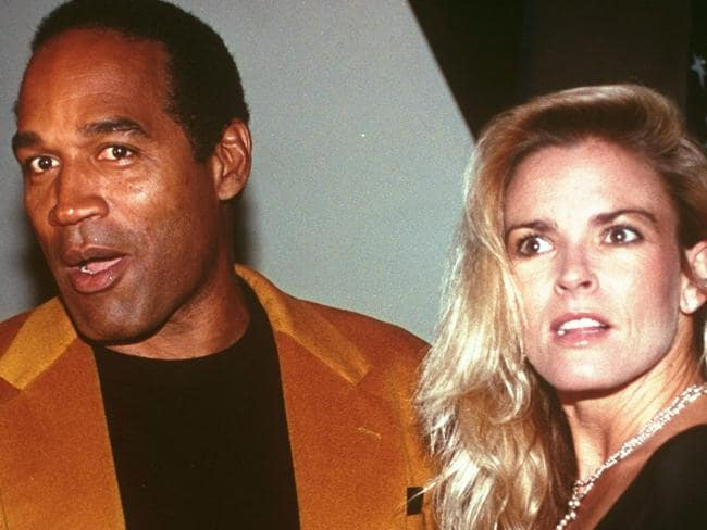 OJ Simpson and his wife Nicole Brown Simpson celebrate the opening of the Harley-Davidson Cafe in 1993.