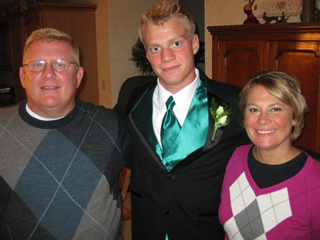 Family broken but forgiving ... Chris Walker, 21, with his father Bill and mother Mary. Picture: Facebook