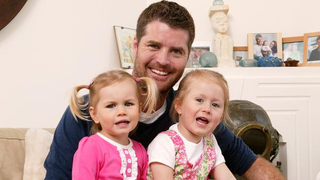 Kids at risk ... experts say Pete Evans, pictured with daughters Indii and Chilli, is hawking a cookbook for babies that includes recipe that may cause death. Picture: John Fotiadis