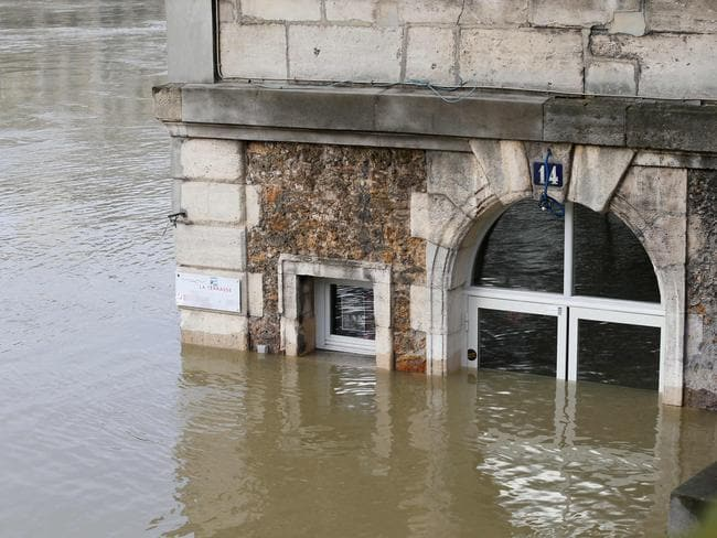 Cafe Les Nautes immersed in the floodwaters. Picture: AFP