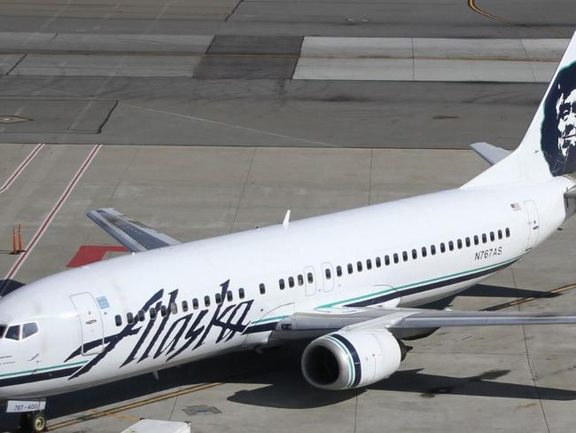 Woman pleads guilty to grope on flight