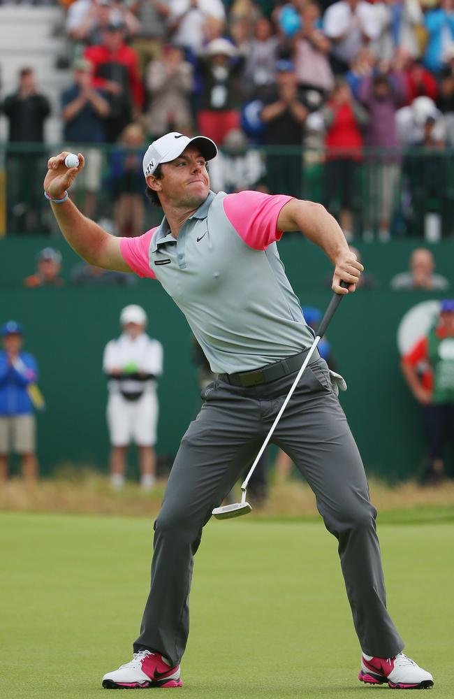 Rory McIlroy tosses his golf ball to the gallery on the 18th green after his two-stroke victory,
