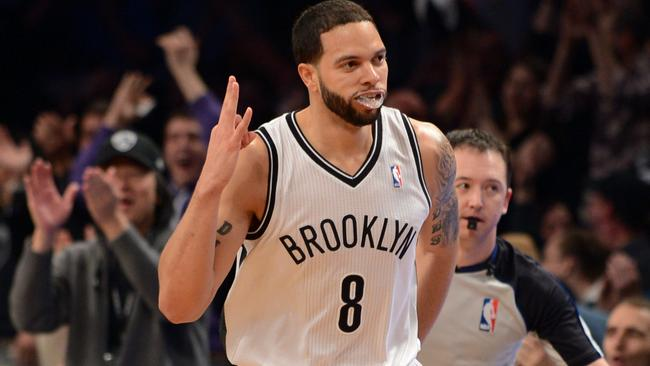 Deron Williams of the Brooklyn Nets holds up three fingers after one of his 3-point field goals.