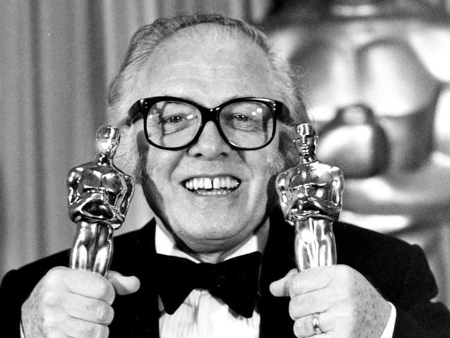 "Richard Attenborough holds his two Oscars for his epic movie ""Gandhi"" at the 55th annual Academy Awards in Los Angeles."