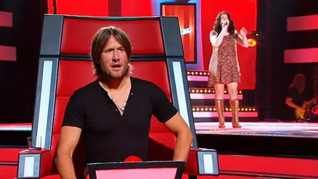 Keith Urban can't believe his ears as Eden belts out It's a Man's World. Channel Nine