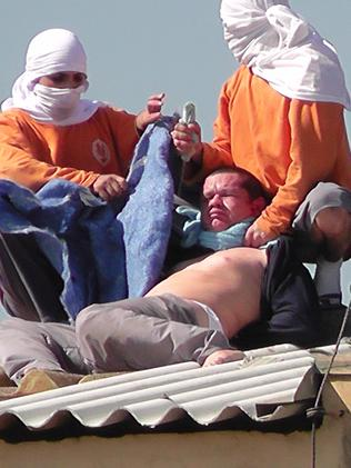 Inmates with a hostage at a prison in Parana, Brazil. Picture: CGN