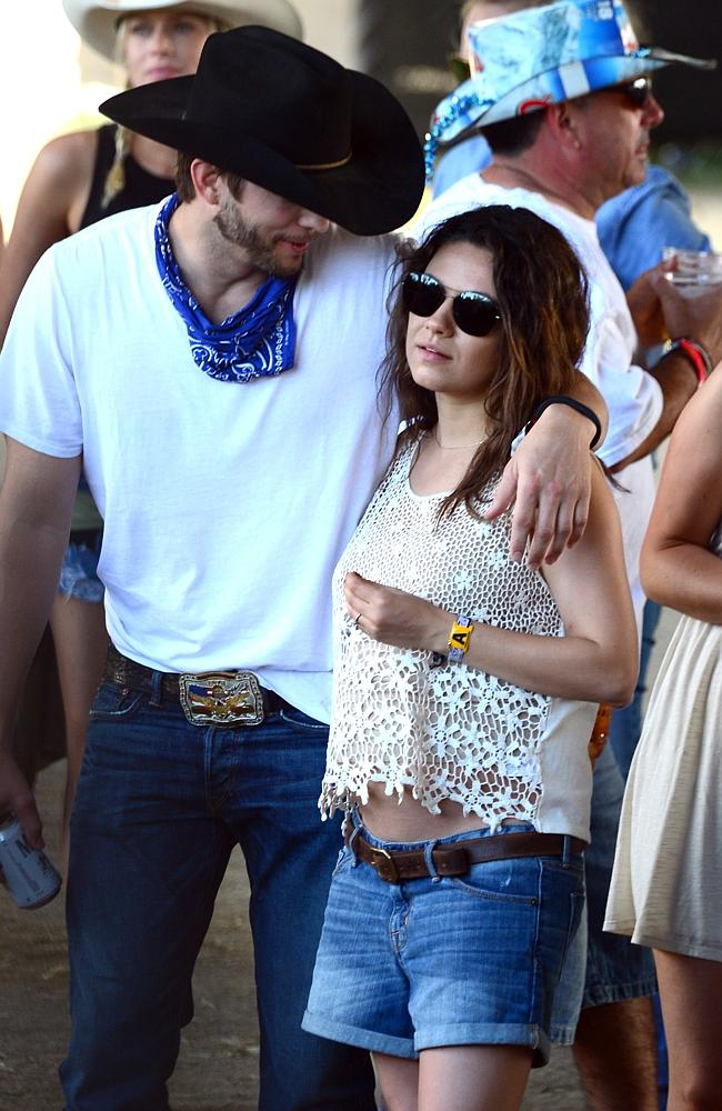 Actors Ashton Kutcher and Mila Kunis seen during day 3 of 2014 Stagecoach. Picture: Getty