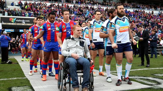 The Knights and Titans come out onto Hunter Stadium with Alex McKinnon. Pic: Gregg Porteous