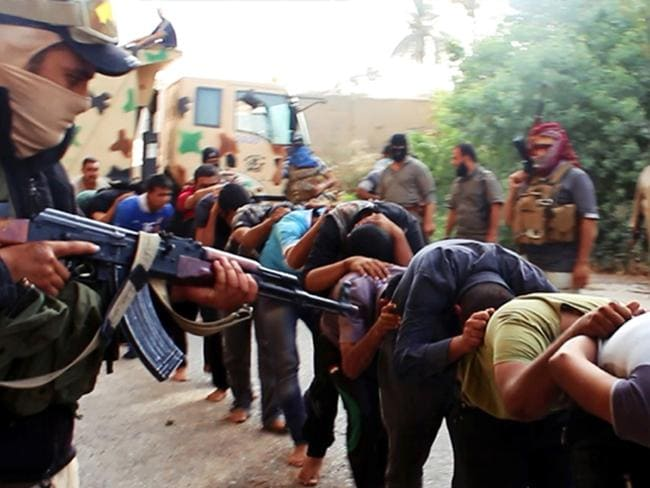 War ... Terrorists from the Islamic State group lead away captured Iraqi soldiers dressed in plain clothes after taking over a base in Tikrit, Iraq. Picture: Getty Images.