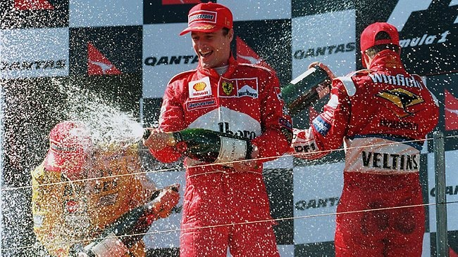 Eddie Irvine soaks the adoring crowd after winning the 1999 Australian Grand Prix.