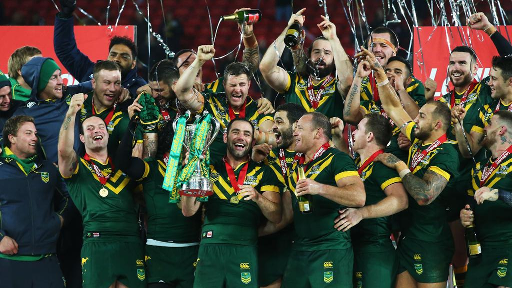 Cameron Smith of Australia lifts the trophy with teammates after victory in the Four Nations final