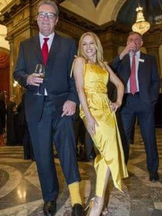 Alexander Downer and Kylie Minogue ham it up at Australia House in London.