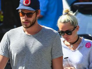 MILEY CYRUS AND LIAM HEMSWORTH HEAD OUT FOR BREAKFAST IN BYRON BAY