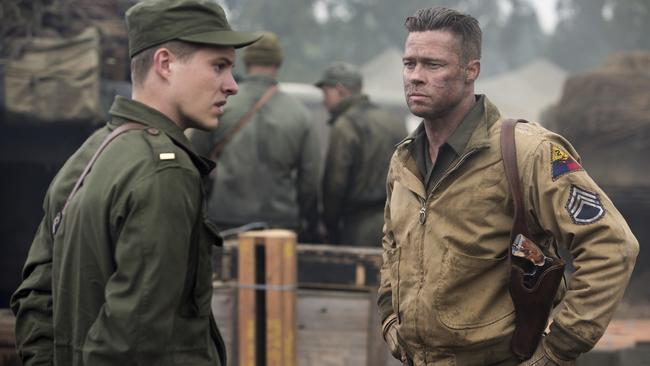 Big screen ... Xavier Samuel orders Brad Pitt around in Fury, due out in November.